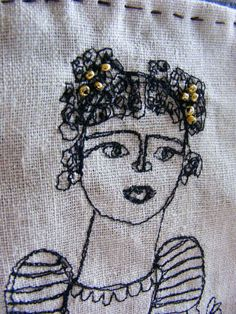 Flowers in my arms- embroidery artwork freestyle and hand stitched portrait. £68.00, via Etsy.