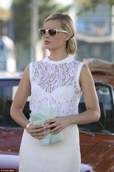 Margot Robbie wears head-to-toe designer clothes and accessories in con caper Focus...