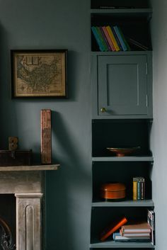 Painting the cupboard, walls and shelf in the same 'Oval Room Blue' by Farrow & Ball creates a beautifully atmospheric look.
