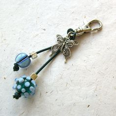 Purse charm, key ring, bag charm, beaded purse charm, silver butterfly charm, lampwork beads,. £9.50, via Etsy.