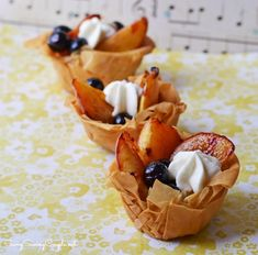 Grilled Peaches and Blueberries with a dollop of fresh whipped cream in a filo dough fruit tart. *Learn how to grill peaches, and work with filo dough!