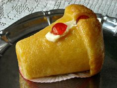 Italian Food ~ Babà al limoncello ~ the Italian version of Baba au Rhum. A sweet yeast dough is baked in molds, unmolded, then soaked an a liqueur laced sugar syrup.