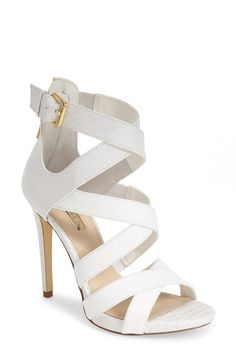 Free shipping and returns on GUESS 'Abby' Strappy Sandal (Women) at Nordstrom.com. A reptile-embossed wrapped stiletto heel, counter and crisscrossing ankle strap lend an exotic air to this standout sandal with gleaming hardware for a polished finish.