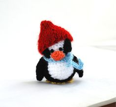 $31.34 crochet penguin, tiny penguin doll with red hat and blue scarf, little #penguin doll, little crochet #cuteness, tiny penguin made by crochAndi