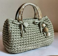 crochet bag- love the bag - don't like the solid handles- they hurt when you carry them:
