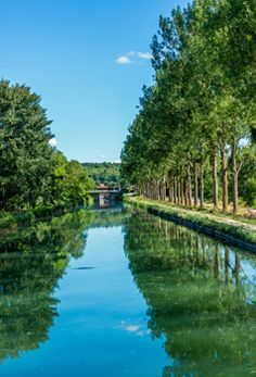 Burgundy, France - The Burgundy Canal winds its way in smooth curves through the heart of renowned wine growing areas such as Chablis, Côte de Beaune and Côte de Nuits, or rises steeply through a flight of locks that appear like staircases.