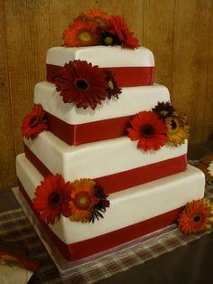 - fresh flowers adorn this fondant covered cake