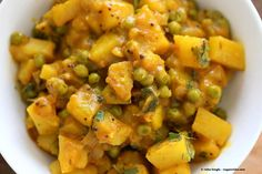 Recipe for vegan Bombay potatoes and peas. Posted on veganricha.com by Richa.