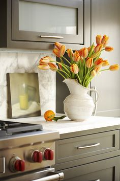 cabinet color, counter & backsplash material *makes any color of seasonal flower arrangements/kitchen accessories PoP!! ... lovely