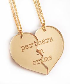 Partners in Crime Necklace Set - Gold    This necklace set features two custom designed pendants made from laser cut and engraved gold