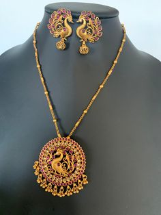 Antique Matte Gold finished peacock pendant set with matching earrings / Indian wedding jewelry/ Temple jewelry/ Bridal jewelry