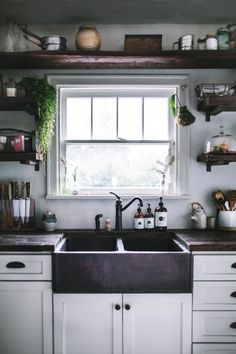 Open shelves around kitchen sink and window. Mine won't be quite so dark and I won't have a shelf overhead