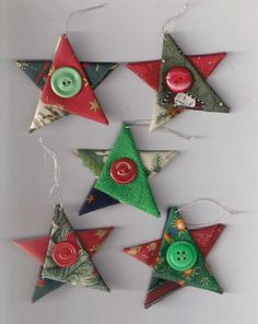 A set of five Christmas tree ornaments in the shape of stars, created from a variety of folded Christmas fabrics in red, blue, green, white, silver and gold. They have a silver hanging loop, and a red or green vintage button in the centre. Each star measures approximately 7.5cm (3in) tall/wide and the hanging loop is approximately 4cm (1.5in) long. Colours of the stars will vary - if youd prefer particular colours, please leave me a message in the note to seller section when checking out…