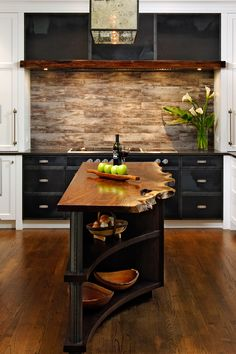 Fiery reds, deep purples and cool blues are eye-catching, but subtler shades add depth, too. Choose a treated wood—like a light oak or a warmer black walnut—for your cabinets or even as a countertop to warm the space up. - ELLEDecor.com