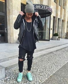 Street Goth style on top.  Ripped knee black jeans. Skinny. Long fit black shirt.  Leather jacket.  Men style.  Fashionista.  2015 adidas superstar pharrel Williams edition