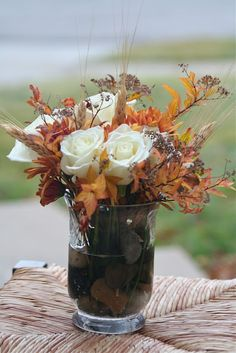 Roses, fall leaves with submerged river rocks