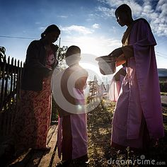 Photo about Myanmar - lake Inle - the morning begging. Image of prayers, buddhism, hand - 58806106 Buddhism, Vectors, Prayers, Editorial, Sign, Stock Photos, Free, Image, Prayer