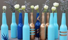 Painted Beer Bottles; not as tall as wine bottles therefore easier for your guests to chat!