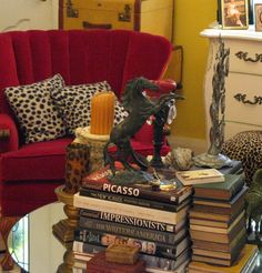 red chair, animal print ottoman, books galore!