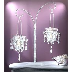 Tie in the large chandeliers you use for impact to your centerpieces and keep it classy -  MINI CHANDELIER CENTERPIECES