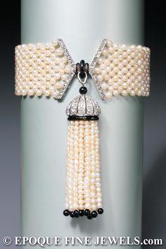 Mauboussin, Paris ,An early Art Deco natural pearl, enamel, onyx and diamond tassel bracelet,