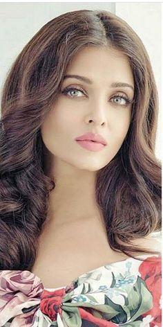 Aishwarya Damn she's beautiful. Those eyes, lips and that hair!