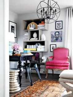 Wonderful workspace. This home office feels like anything but work with the beautifully curated accents and personal touches that surround the desk. The unusual book shelf of stacked boxes (a relatively easy DIY inspiration), bright pink velvet chair and beautiful table lamp and chandelier makes this an office oasis. When creating a command station for your email and bills, keep everything you need in one desk drawer or storage box.
