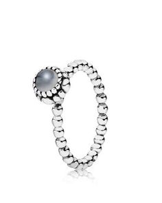 This birthstone ring features a beaded silver band with a polished grey moonstone solitaire. Perfect worn on its own or stacked with other Pandora pieces. | Imported | Sterling silver/moonstone | Styl