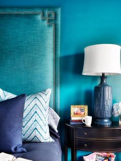 This watery bedroom proves that a high-end look can be had on the cheap. Designer Brian Patrick Flynn turned 6 yards of bargain fabric into a custom 7-foot-tall teal headboard, then matched the wall hue for a subtle, textured look.