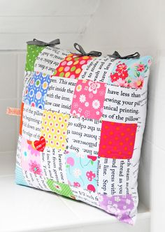 Scrappy cushion with text printed fabric | Helen Philipps