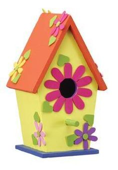 A cheery birdhouse adds bright spring color to your patio or yard.