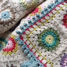 The Sunburst pattern by Priscilla Hewitt using Scheepjes Stonewashed yarn. Bobble border in color #813 http://www.ravelry.com/patterns/library/sunburst-granny-squares