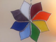 This colorful 6 1/2 inch pinwheel is made from brilliantly colored stained glass. Using the colors of the rainbow, the sun catcher is made with 8 different colors of premium glass. Each piece is hand cut, sanded, wrapped in copper foil and soldered together. The sun catcher is then