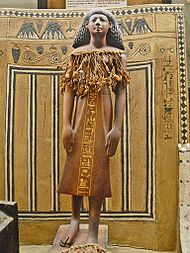 Statuette of Kha, a wealthy architect of the late 18th Dynasty of Egypt. His tomb was found with all burial goods intact. Clothing, food, pottery, household linens etc. were found in great shape. Kah and his wife Merit were not embalmed, but they were wrapped as mummies. @ wikipedia.org