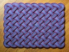 Cool rope rug.  Also check out the how-to video: http://www.youtube.com/watch?v=KV6LCl_4voE#at=79 even better: http://www.youtube.com/watch?v=_VdOId9jmN8