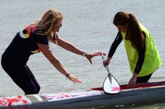 Katie (14yrs) our youngest competitor being welcomed to shore by Mandy.