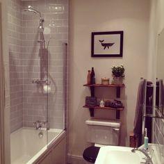 Grey tiles & bathroom shelves.