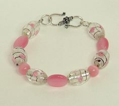 Pink And Silver Catseye And Lampwork Bracelet - pinned by pin4etsy.com