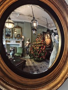 Reflecting on Christmas into our showroom through a good overscale Regency carved giltwood convex #mirror.