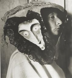 Remedios Varo wearing a mask made by Leonora Carrington and Kati Horna, 1957
