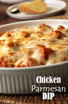 Chicken Parmesan Dip Recipe - Grab a breadstick and dig into this yummy dip that has all the flavor of Chicken Parm without all the work. 20 minutes in the oven is all it takes to serve this impressive appetizer to all your friends.