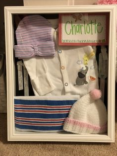 My shadow box with Charlotte's hospital bracelets, hats, receiving blanket and coming home outfit.