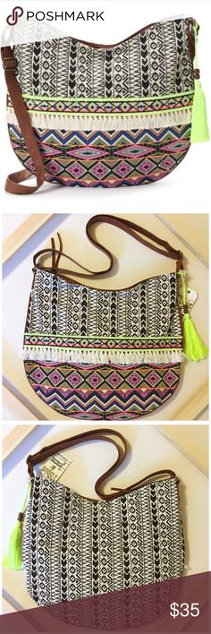 """Woven Tribal Shoulder Bag w/ Tassels and Fringe NWT Woven Tribal Shoulder Bag w/ Tassels and Fringe --- by T-Shirt & Jeans --- tribal print with tassel accent --- burnished gold tone hardware --- 14.25"""" H x 17.25"""" W x 0.5"""" D --- Crossbody strap is adjustable 26"""" - 51"""" --- zipper closure --- interior has 2 slip pockets and one zip pocket --- canvas and faux leather --- thank you for visiting my boutique, please feel free to ask me questions T-Shirt & Jeans Bags"""