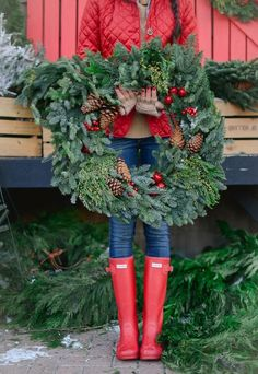 Get ready for a cozy Christmas with red rain boots, an oversize wreath with pine, berries and pinecones (such a good DIY!), and a chill in the air that makes it essential for bundling up in style!!!