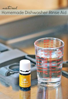 Natural Homemade Dishwasher Rinse Aid - This green DIY natural rinse aid with essential oils for your dishwasher will save you money and ensure your dishes are clean every time.