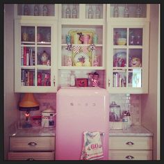 Kitchen post renovation.  custom built space just for this little pink fridge which now holds drinks.  So cute.