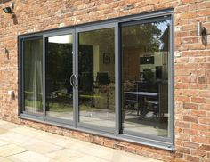Aluminium windows vs Wood & uPVC - what's the difference? Aluminium windows can add value to your property and help reduce your energy consumption. Upvc Windows, Aluminium Windows, Windows And Doors, Grey Windows, House Doors, House Windows, Sliding Patio Doors, Sliding Glass Door, Grey Window Frames