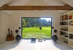 Cool Window Home Music Studio Room. It just needs filling with some nice toys!