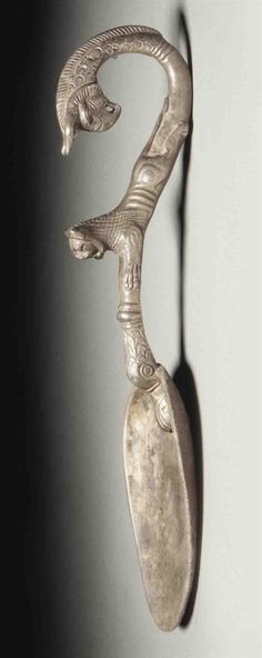 ACHAEMENID SILVER SPOON, 4TH CENTURY BC  With a duck's head (at the bowl), a leaping lion and a griffin.