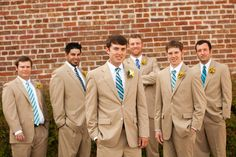 khaki suit for him white shirt and matching ties (lime green or teal) with khaki pants for boys